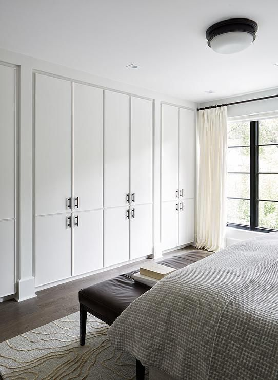 Modern brown and gray bedroom is fitted with a wall lined with