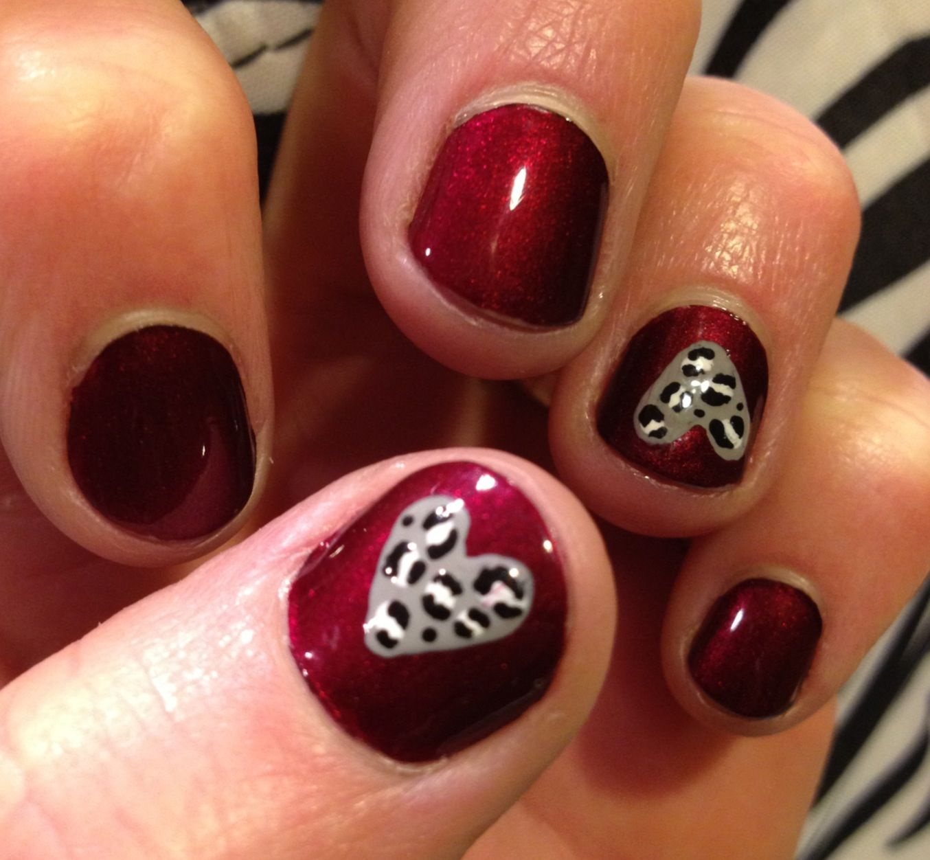 Snow leopard hearts with Sally Hansen Insta-Dry color Wined Up