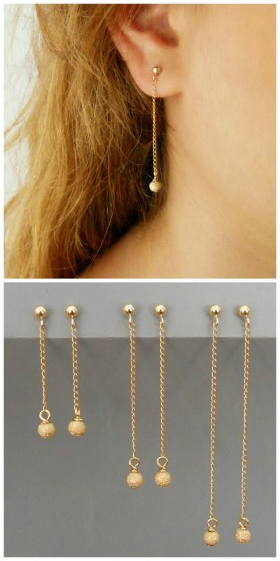 A Pair Of Gold Dangling Stardust Earrings Available In 3 Diffe Lengths