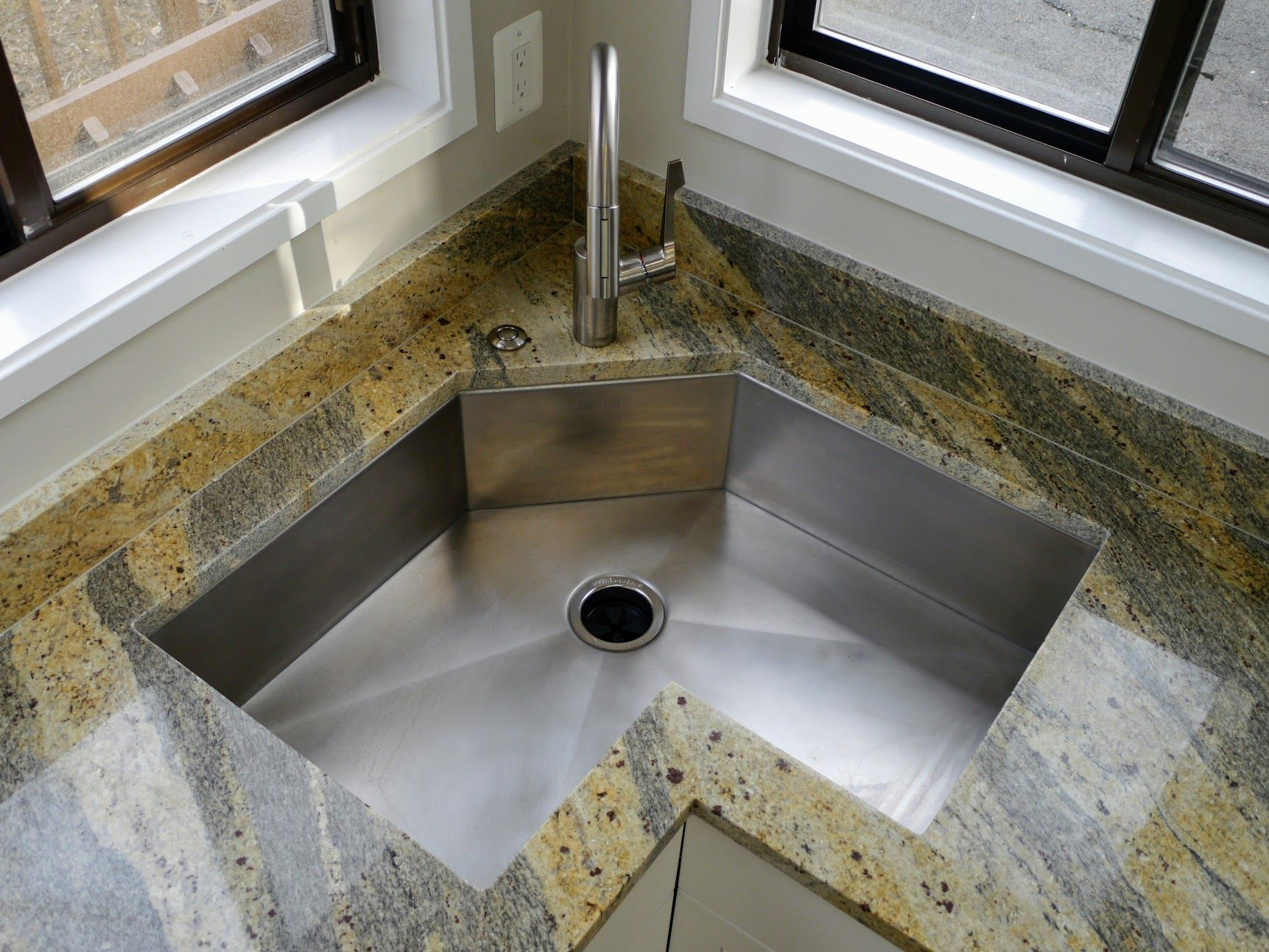 Rustic matte stainless steel under mount sink shown with a