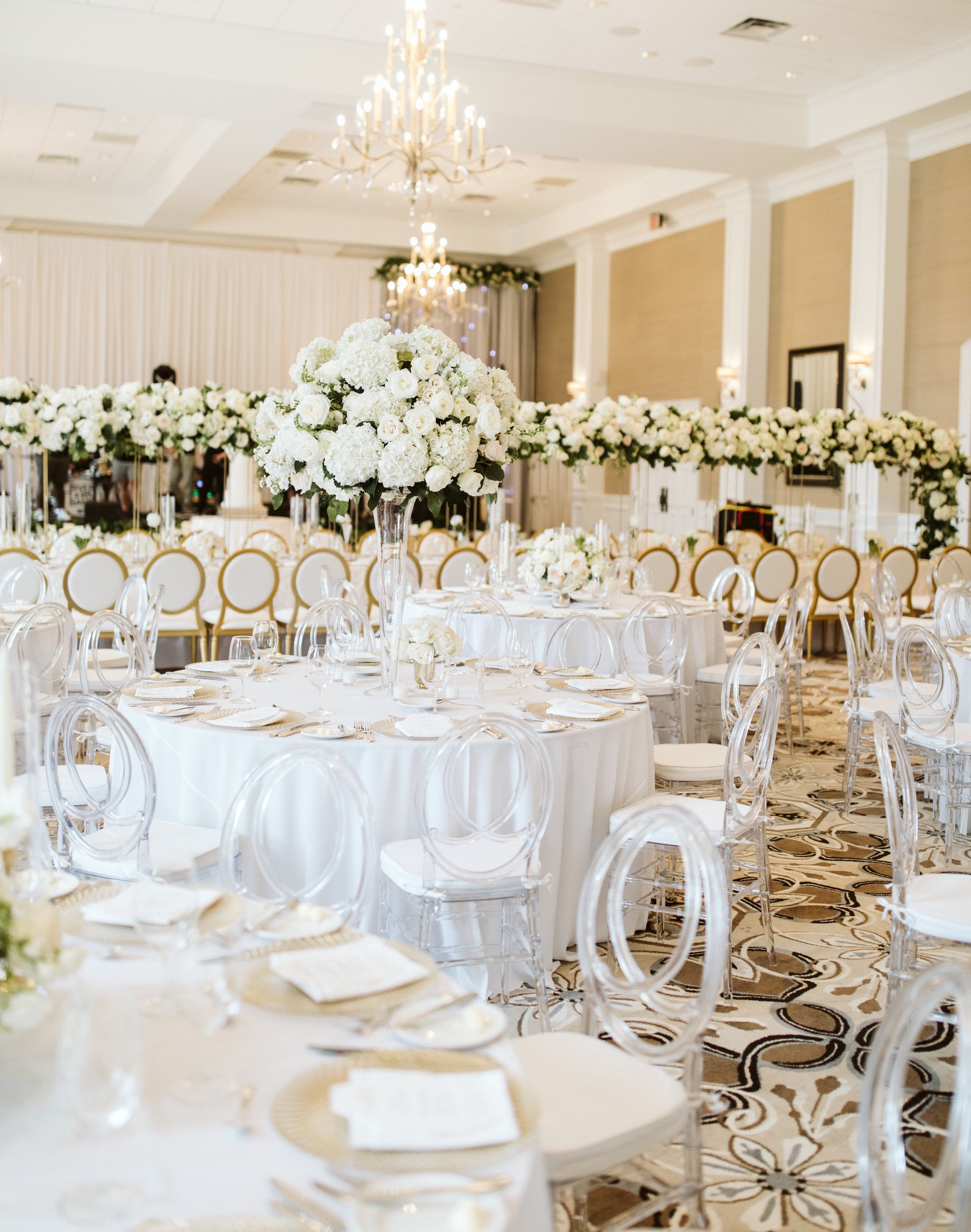 Modern Elegance For This Grand Ballroom Wedding Reception Included All White Flowers Wedding Styles Themes Ballroom Wedding Reception Wedding Reception Chairs