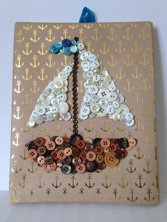 Add a touch of nautical decor to your home with a custom handmade button boat.  The piece features buttons layered on top of buttons to give it a