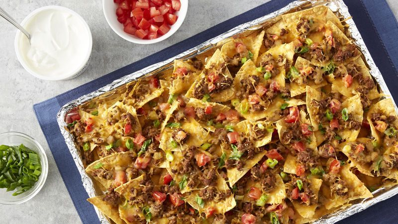 Beef Nachos An easy, classic beef nachos recipe for all your nacho cravings! Seasoned with green chiles, taco seasoning and green onions, this seven-ingredient recipe will not disappoint. Once you've tried this, you'll never need to look for another beef nachos recipe again.An easy, classic beef nachos recipe for all your nacho cravings! Seasoned wi...