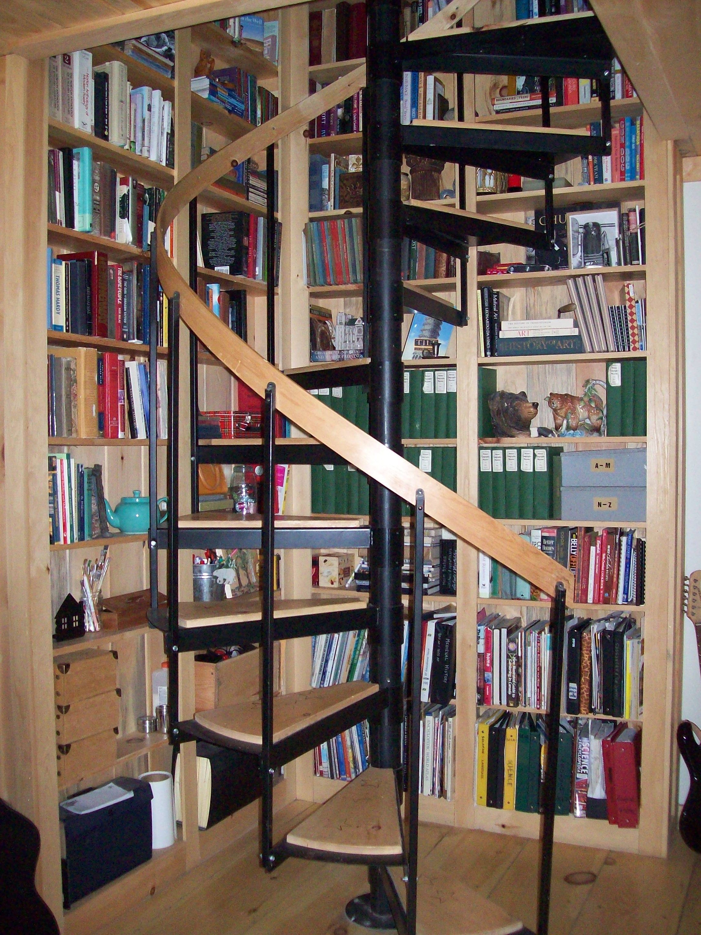 Bookcases Built In Behind Spiral Stairs Use Every Inch Of Space.does A Spiral  Stair Save Space More Than A Traditional Staircase?