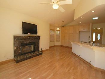 Living room near kitchen with a fireplace!