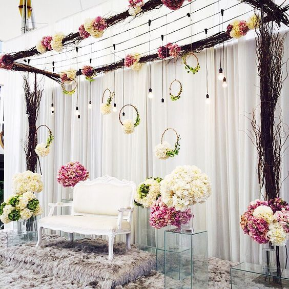 Gorgeous Stage Decor With Hanging Light Bulbs And Floral