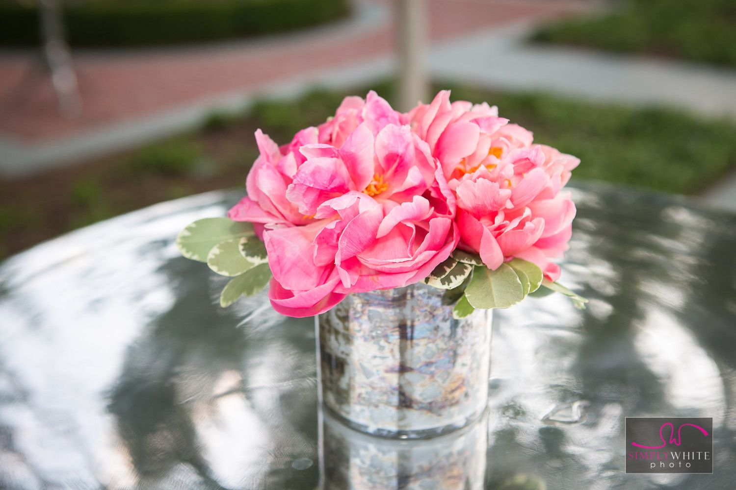 Pretty pink flowers for engagement party. Spring time engagement and photos.