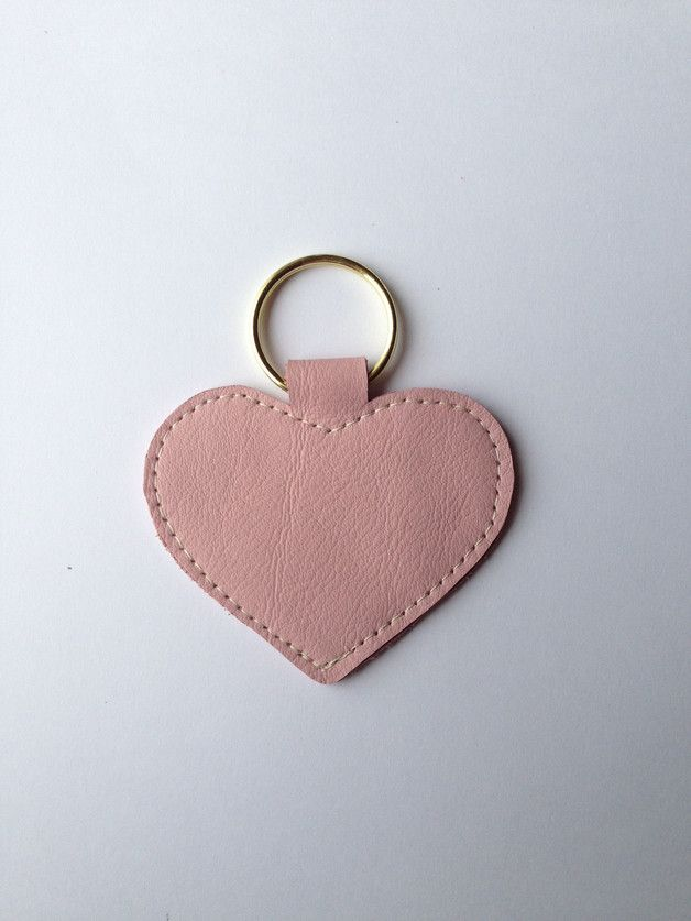 Photo of Pink heart keychain handmade from genuine leather. The key fob …