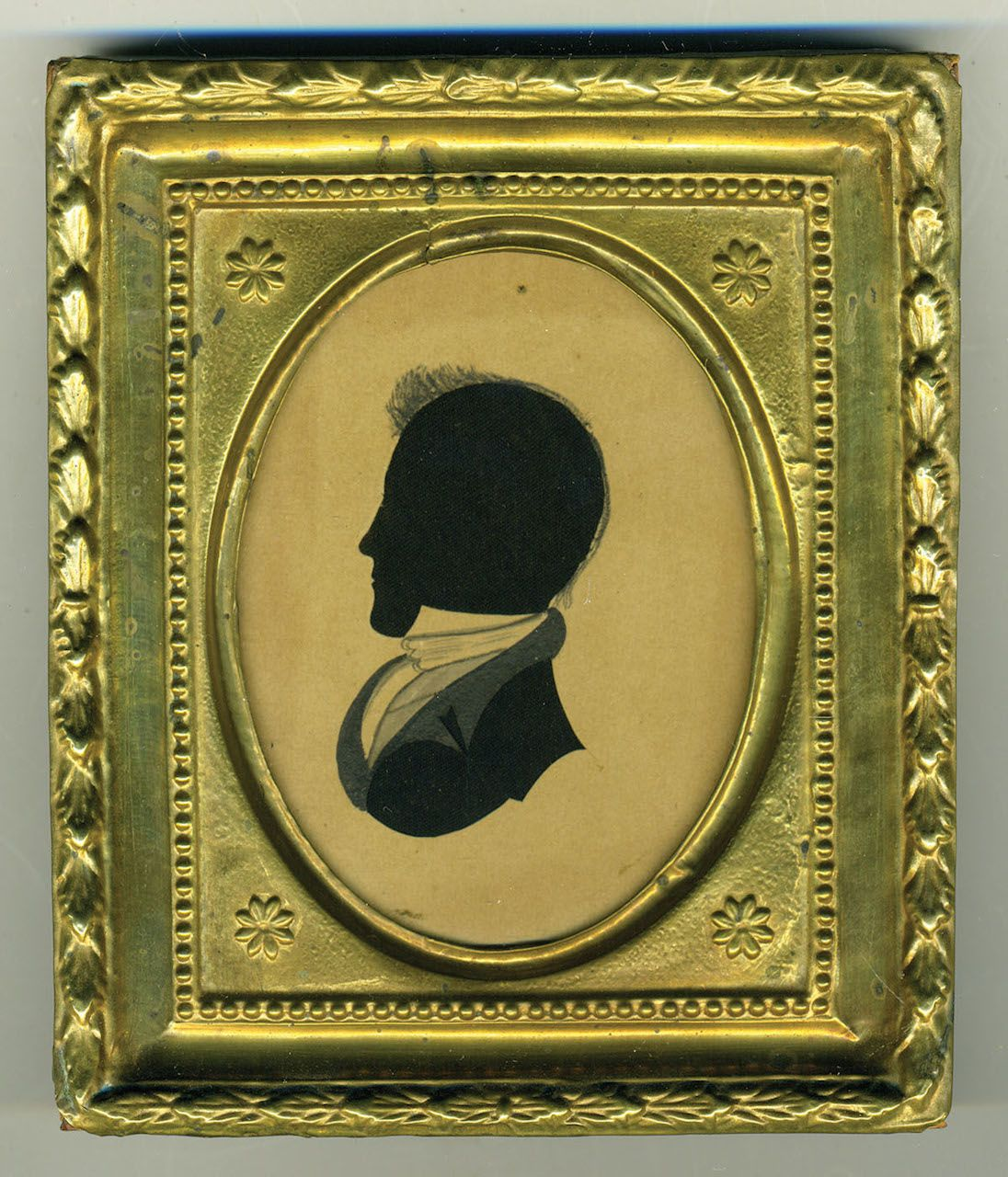 """Part of a pair of 19th-century hollow-cut silhouettes showing a woman and gentleman on black silk, with watercolor bodies, in gilt repousse frames, both attributed to the so-called """"Dash Artist"""""""