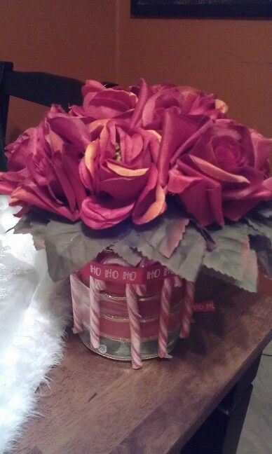Red roses with candy cane vase