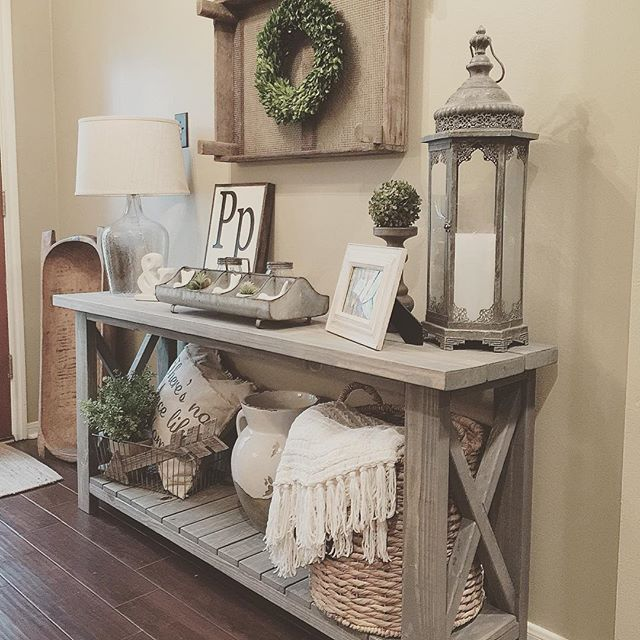 Farmhouse console table vignette in a foyer