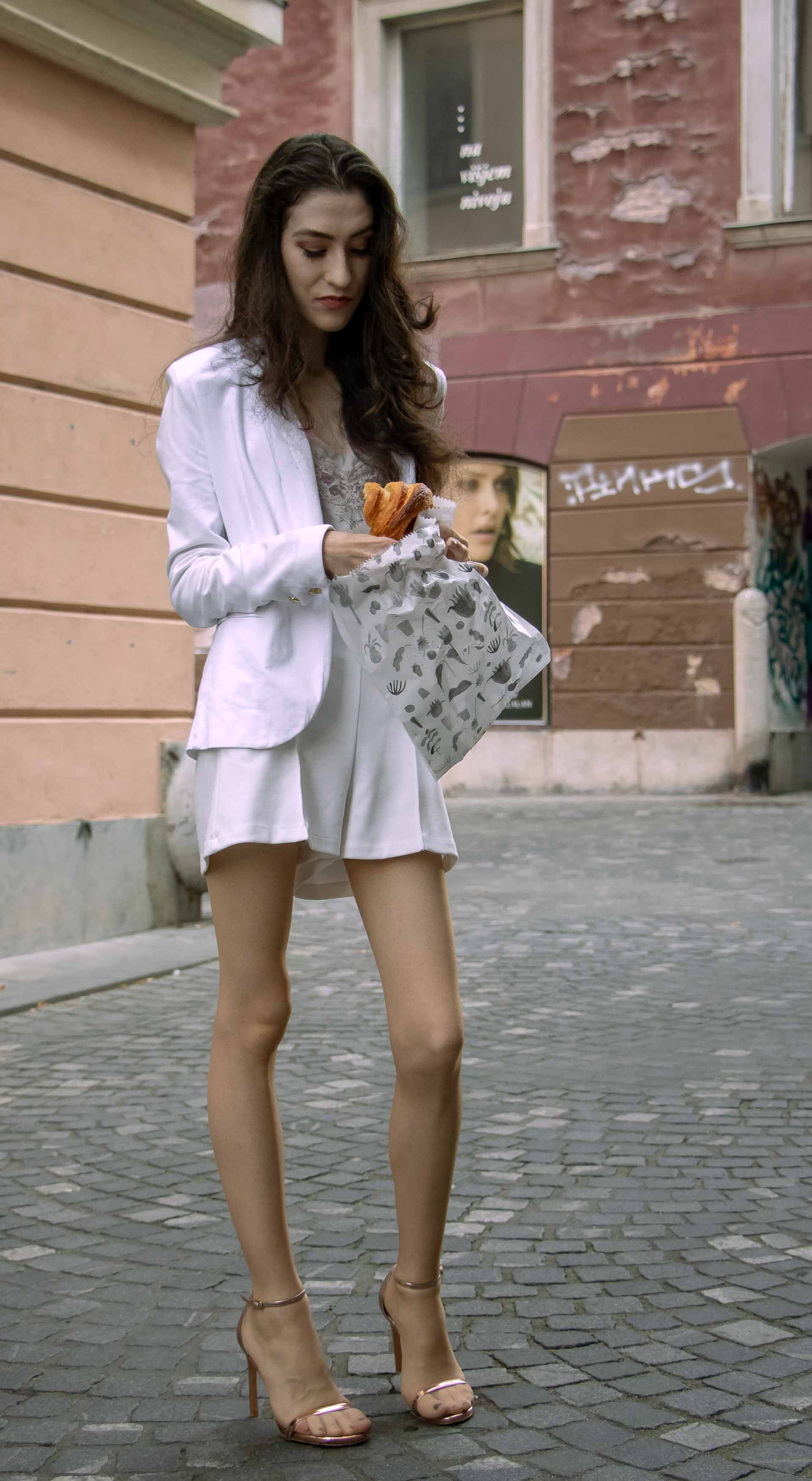 a95497e8b9ca Beautiful Slovenian Fashion Blogger Veronika Lipar of Brunette from Wall  wearing all in white suit