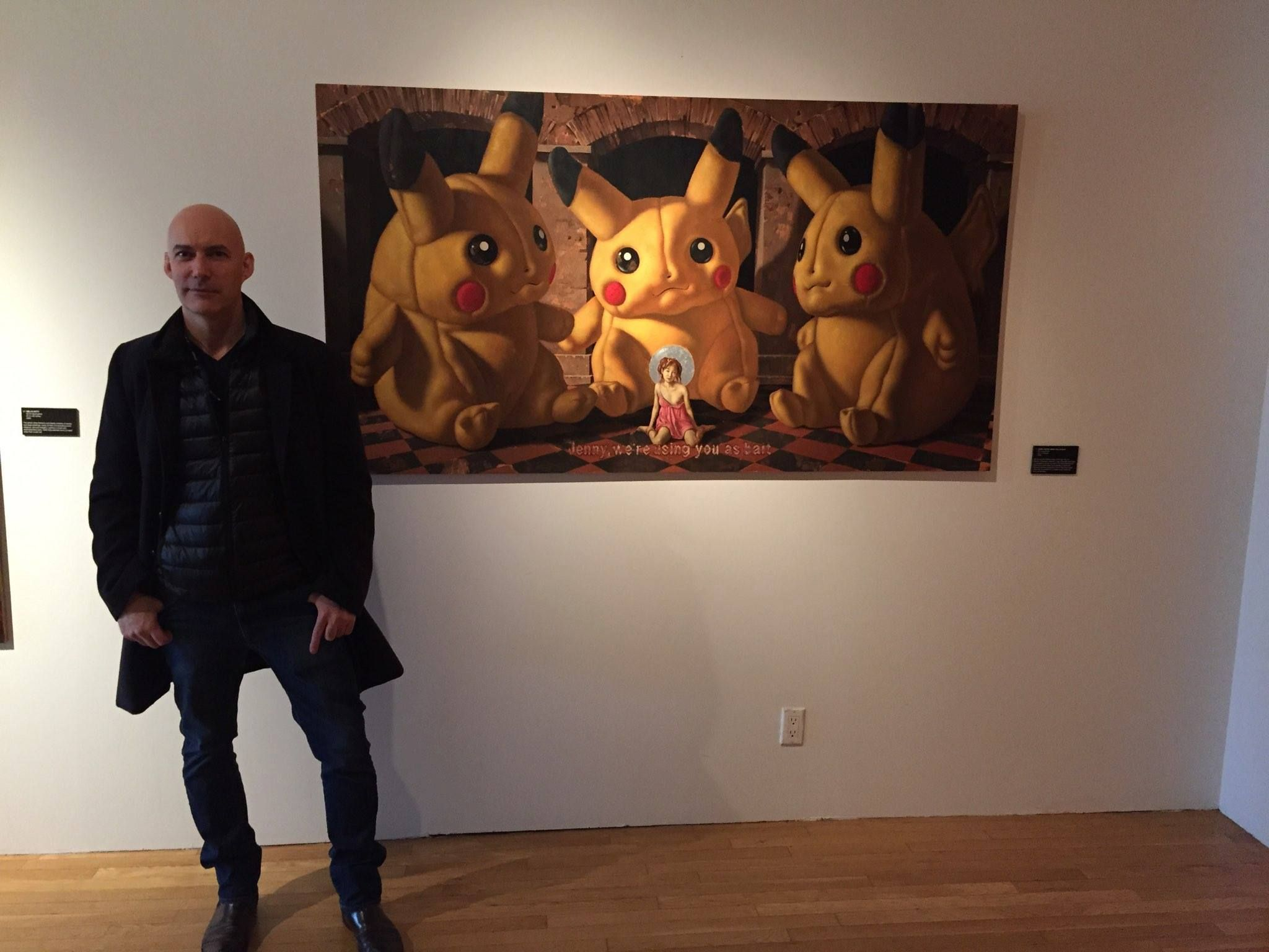 """Artist John Wellington at his solo New York exhibition celebrating 30 years of his amazing paintings. This is John with the his Pikachu painting """"Jenny, We're Using You As Bait."""" Full size print available at ObsessionArt - http://goo.gl/xdRbWR"""