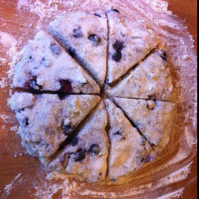 Simple breakfast scones. Substitute your favorite berry/fruit for the raisins from this recipe: http://m.allrecipes.com/recipe/79470/simple-scones