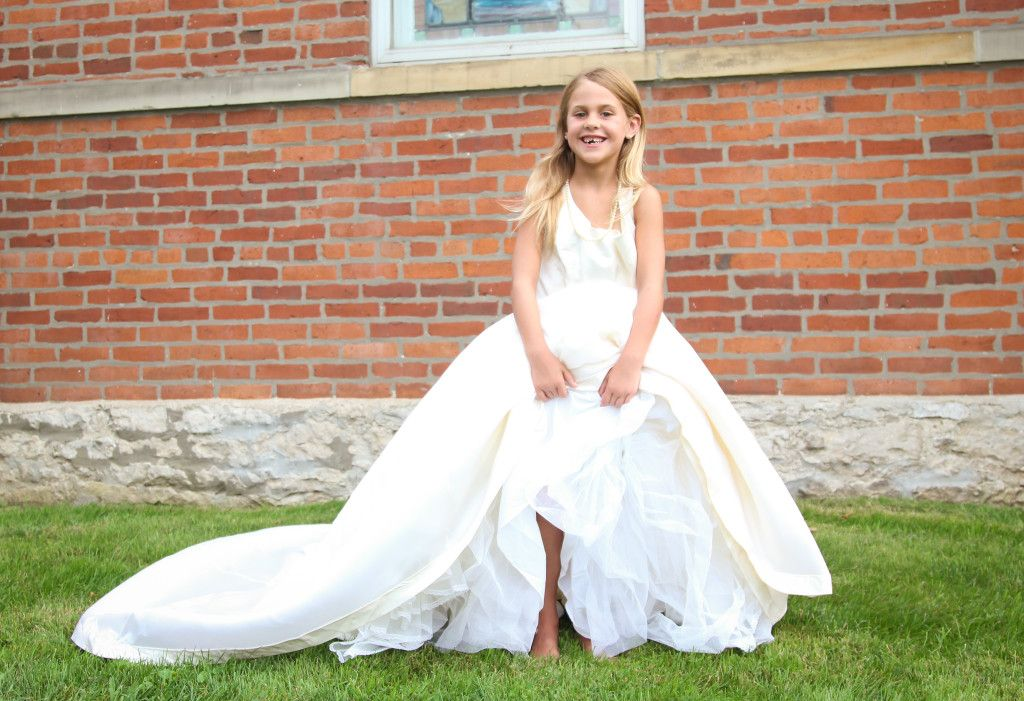 Dressing up in Mom's wedding dress for a beautiful photo shoot. Keller Photography in Columbus Ohio.
