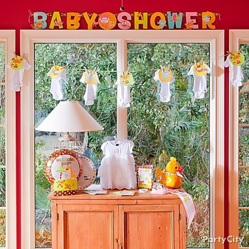 Jungle Animals Baby Shower Ideas #babymemorabilia Grab everyone's attention with a sweet display of the mother-to-be's baby memorabilia and new baby shower accessories. #babymemorabilia