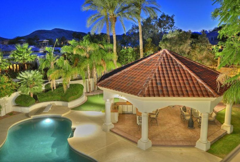 Backyard Mediterranean Style Patio With Pillar Gazebo And Outdoor Kitchen Backyard With An Outdoor Kitche Patio Garden Design Backyard Pavilion Outdoor Remodel