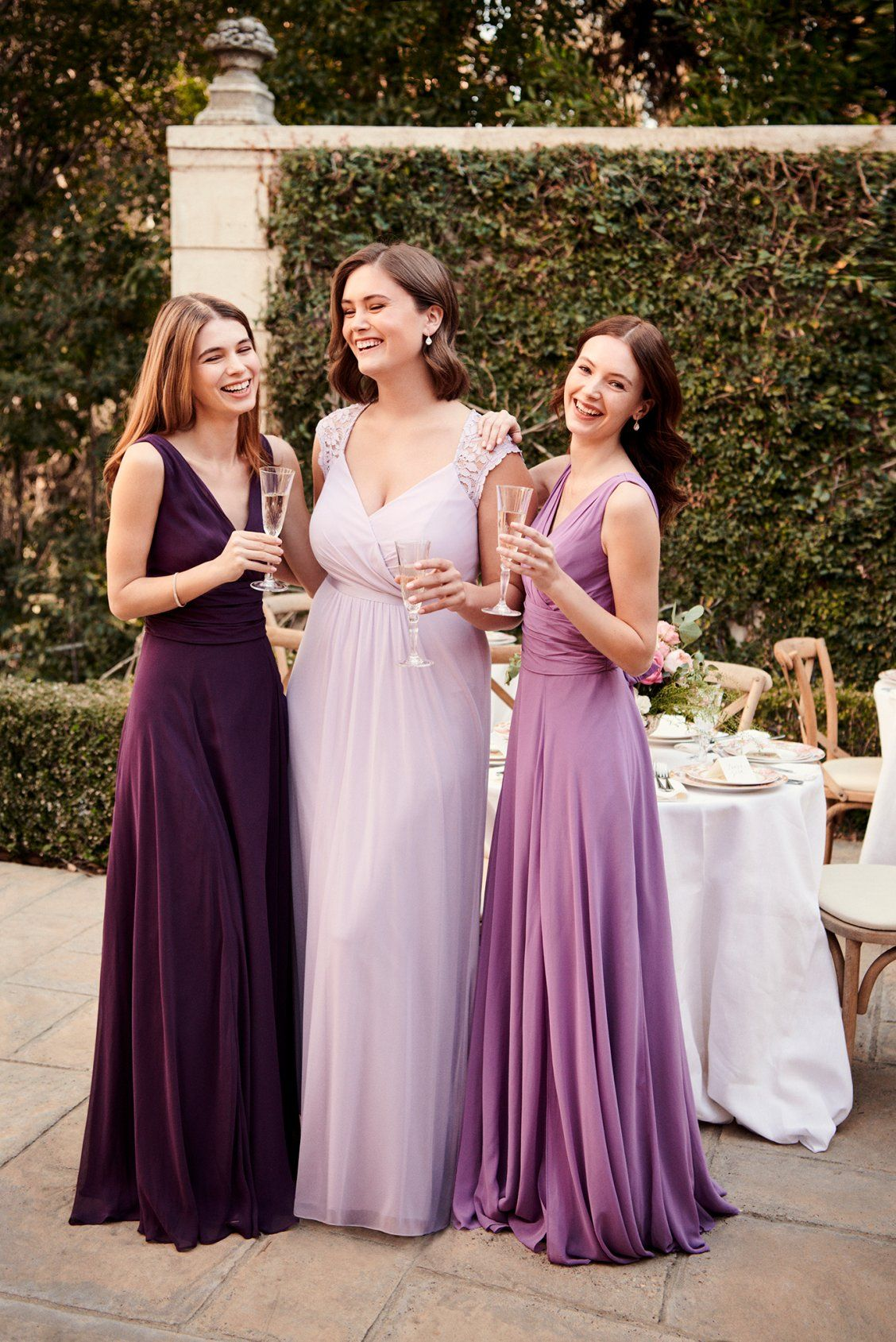 Pretty shades of purple bridesmaid dresses in complementary