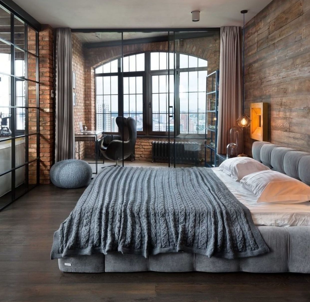 Exposed brick bedroom with private glasses in