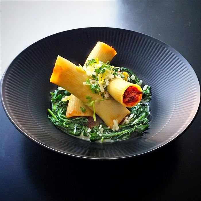 Spaghetti Bolognese, not quite - Cannelloni stuffed with meat sauce on layer of creamy spinach and topped with gremolata.