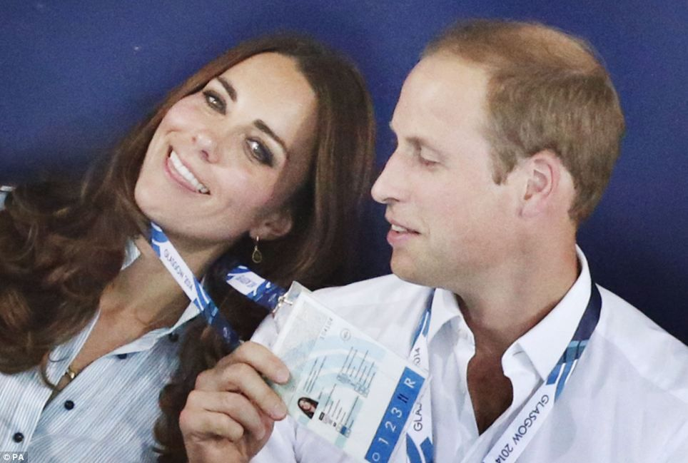 The Duke of Cambridge stepped in to help his over-heating wife today as they cheered on a ...