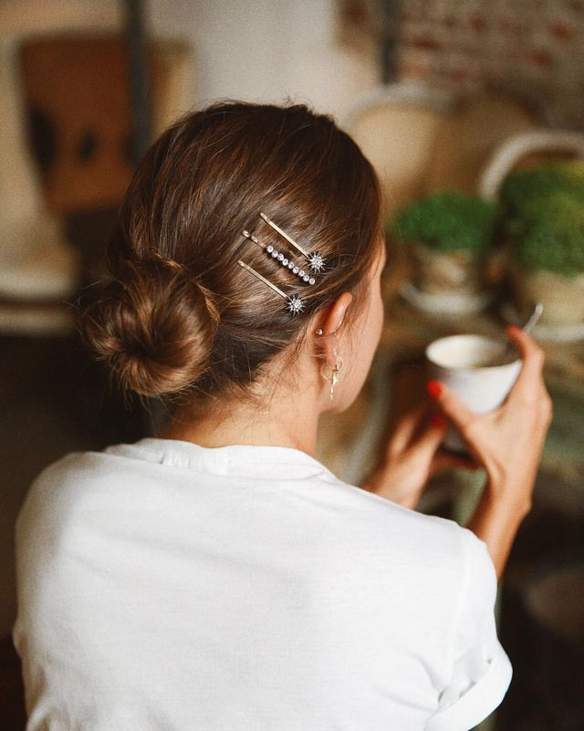 Sleek bun and detailed hair clip accessories