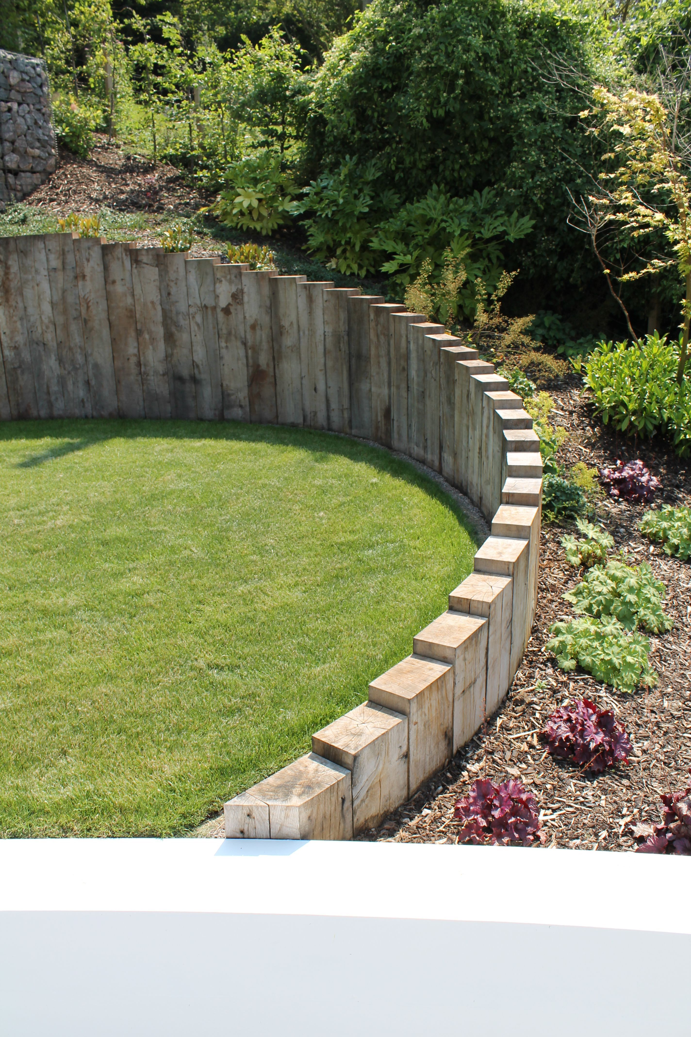 Sleepers Outerspace Back Garden Landscaping Back Garden Design Sloped Garden Backyard garden retaining wall