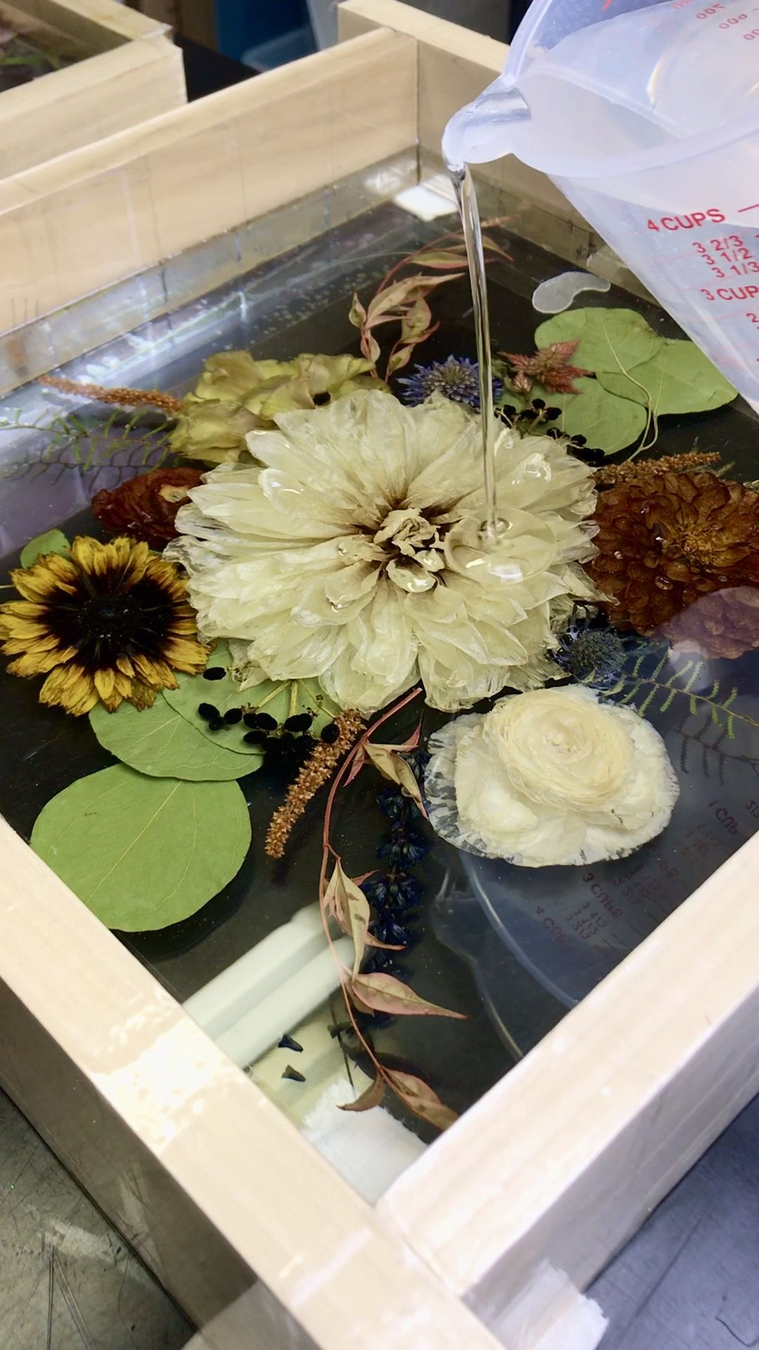 This is not your grandma's dried flowers! Create a stunning art piece for your new home out of your very own wedding flowers! What a cool way to remember your big day forever! Click to find out how!