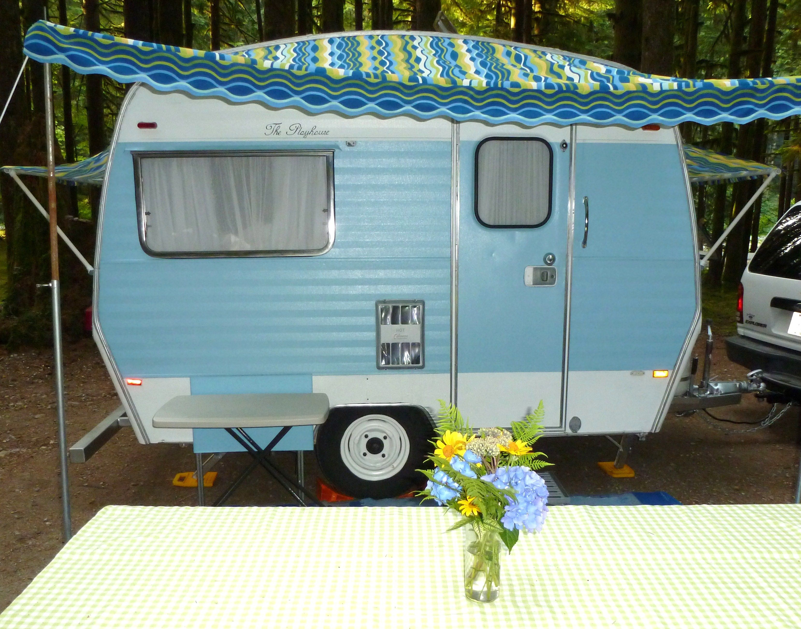 Blue Vintage Caravan With A Great Awning Camping