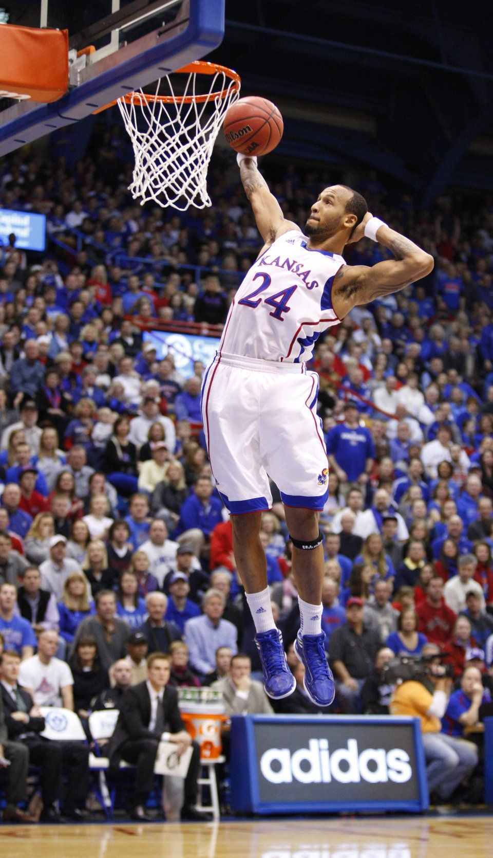 With a hand behind his head, Kansas guard Travis Releford
