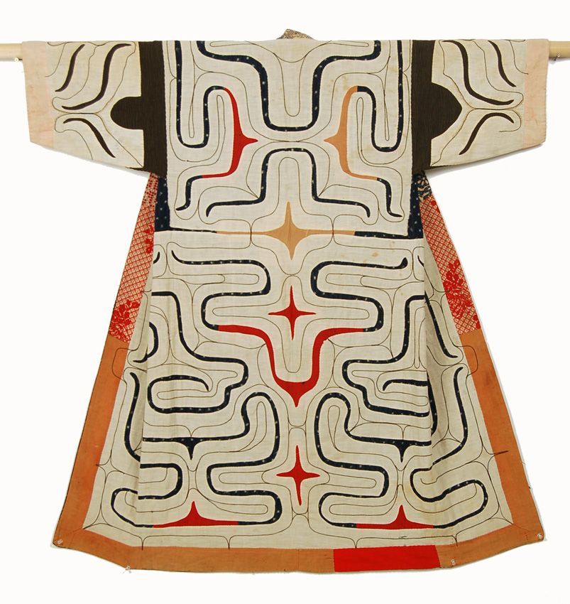 Ainu Robe (chikarkarpe) - The two methods of embelishing the Ainu robes are applique and embroidery, usually combined harmoniously; the severe applique outlines softened by the delicate undulating embroidery. The iconography combines two elements- ovoid motifs and curves used to create a netlike pattern to trap the evil spirits. The design is always symmetrical but as it is done freehand it is never perfectly so. It is also continuous front to back. The body of this ...