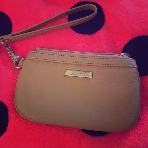 Calvin Klein clutch - small Calvin Klein clutch small - will not fit a phone. cute for going out or everyday use. Calvin Klein Bags Clutches & Wristlets