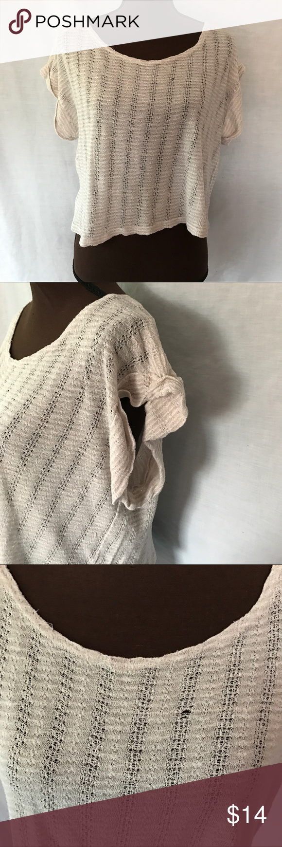 Off-White Cropped Knit Top Somewhat see-through, lightweight and cropped- great shirt for warm weather. There is one small hole, see pictures. Otherwise no visible flaws, EUC.   |✅20% Off Bundles| |✅Questions Welcomed| |✅Reasonable Offers| |⛔️Trades| |⛔️Offline Transactions| |Thrift is Sexy 💋👠 Olivia Moon Tops Crop Tops