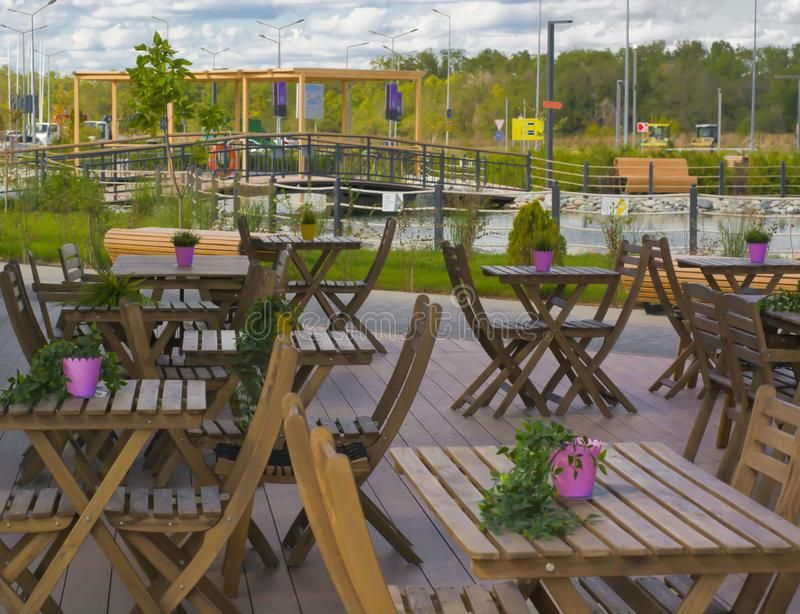 Outdoor Cafe Wooden Tables And Chairs Beautiful Design Summer Beautiful Backg Sponsored Tables Chairs Woode Outdoor Cafe Wooden Tables Cafe Seating