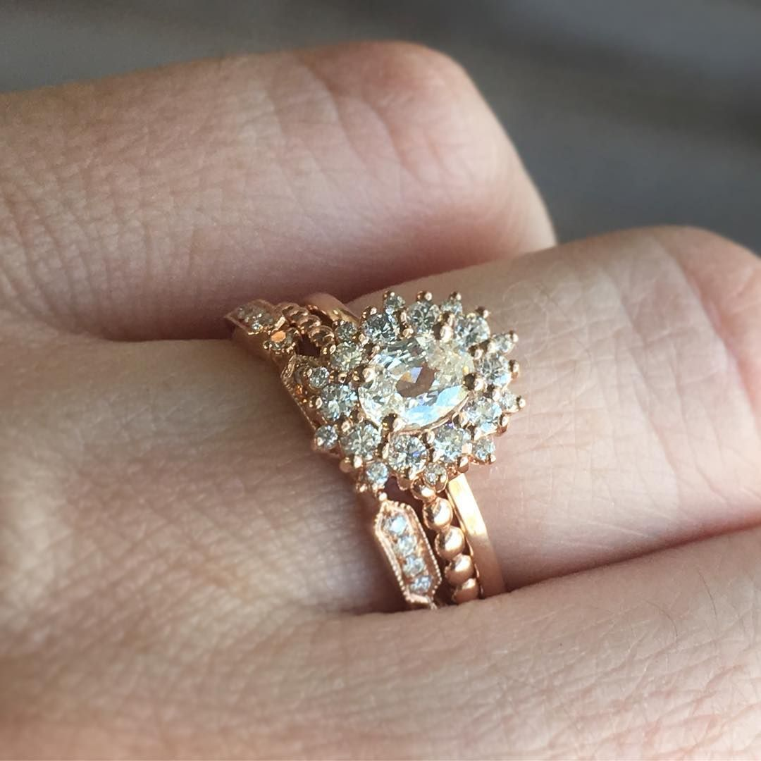 5061c3fe290fc Our new sunburst halo engagement rings stack perfectly with a mix of ...