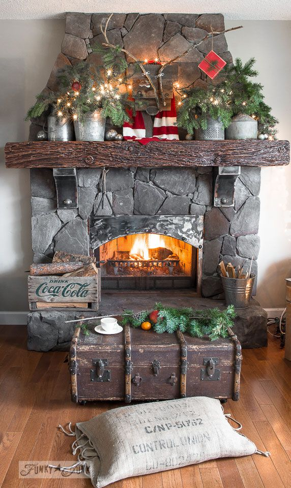 A reclaimed wood deer and Christmas tree mantel Christmas trees
