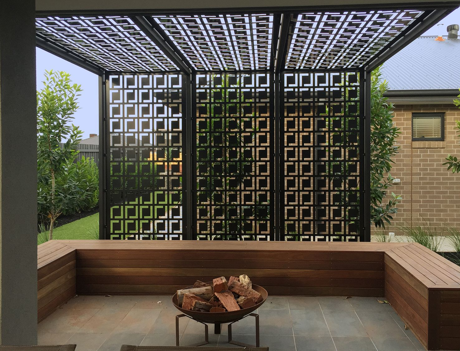 Pergola privacy screen made using decorative screens for Backyard screening ideas