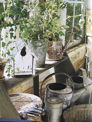 a must have...old watering cans