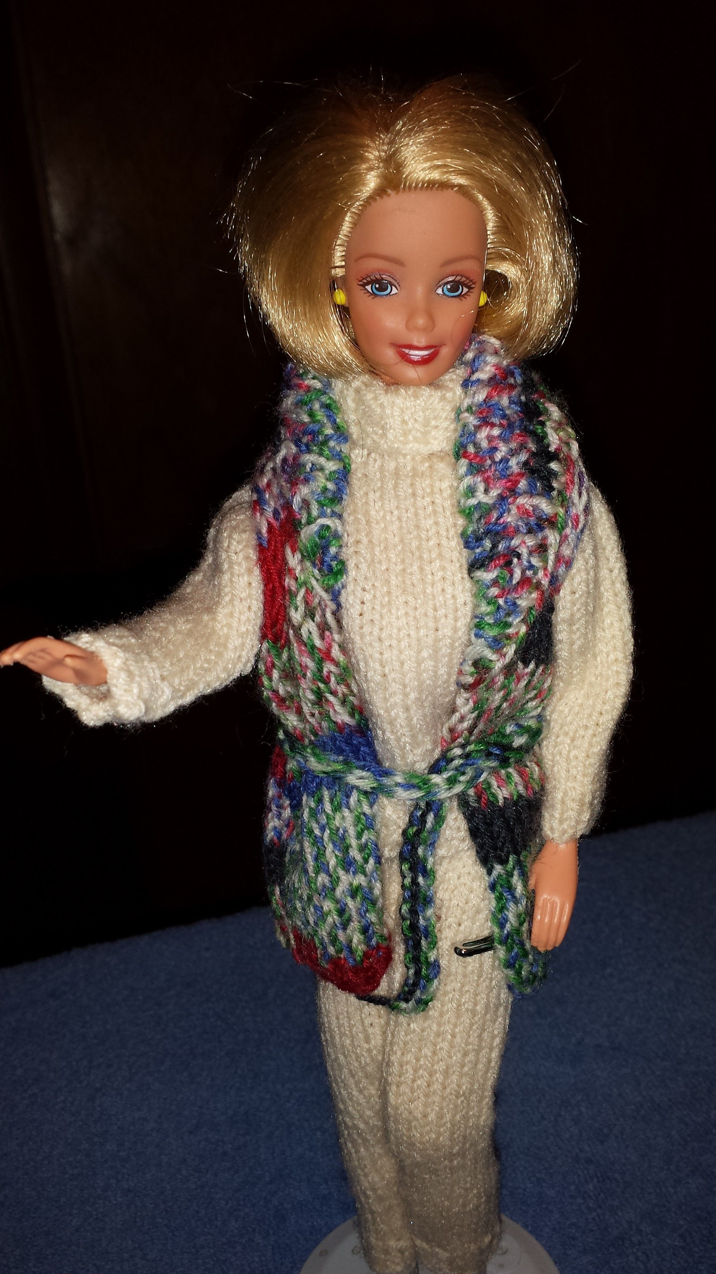 Barbie in yarn, knit patterns re-adjusted to suit the yarn involved ...