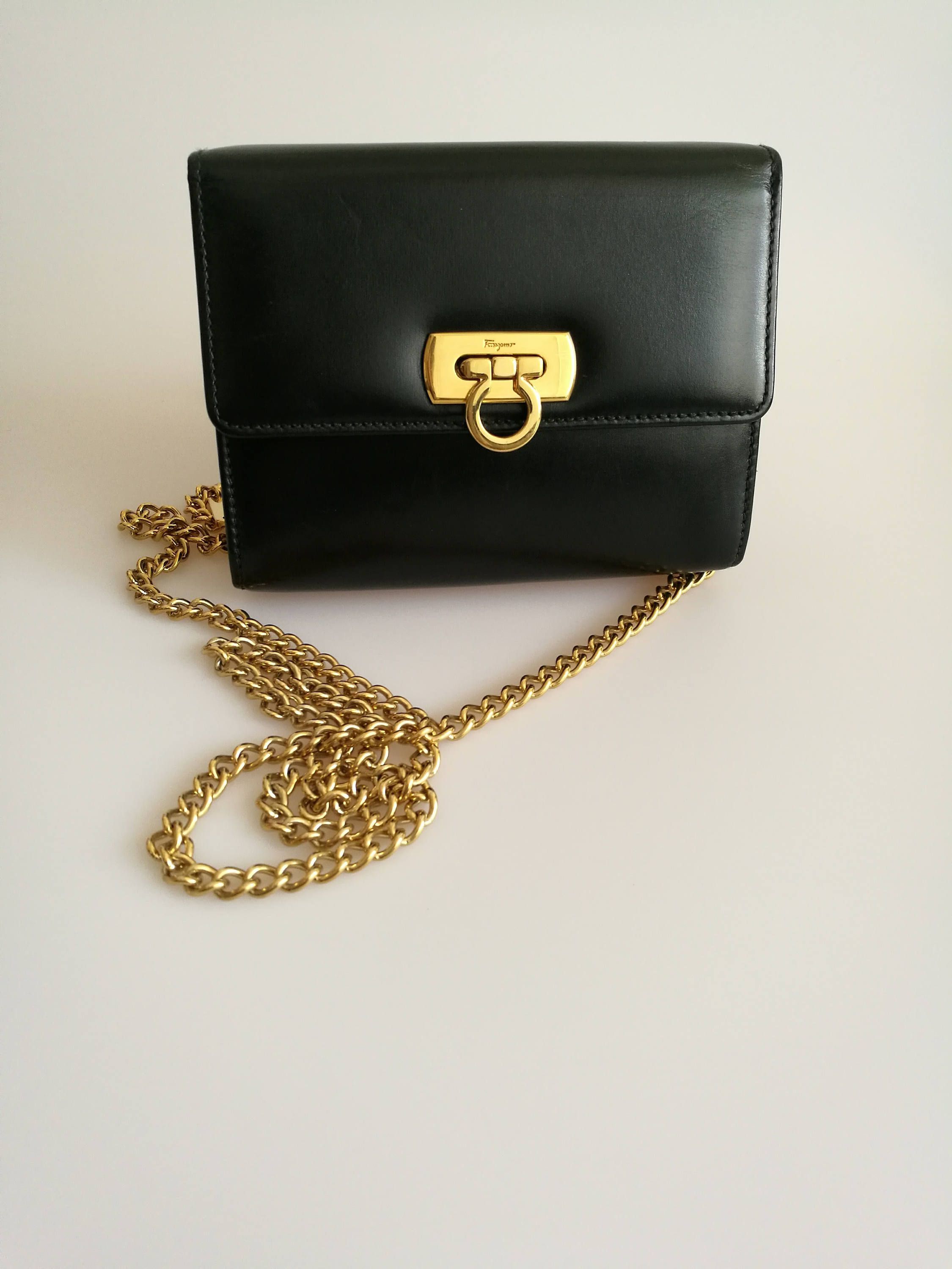 201ba2f5add8 Salvatore Ferragamo Vintage Mini Gancini Black Leather Gold Chain Crossbody Clutch  Bag by DelpheneAvenue on Etsy