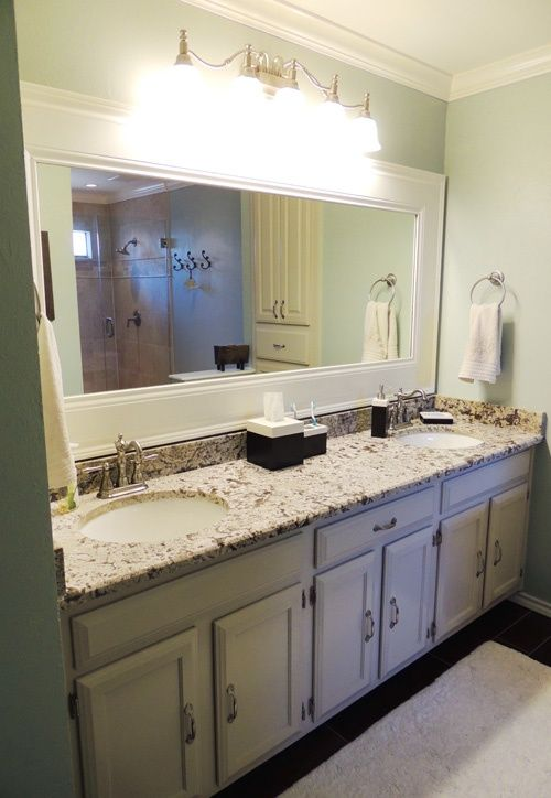 Adding a frame to your bathroom mirror using trim is an ...