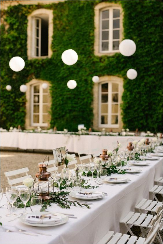copper lanterns, simple greenery and white table top and chairs
