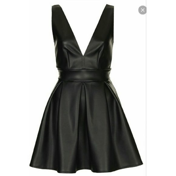 Black faux leather dress NWT Black faux leather dress  Crosses in back  Brand new with tags Dresses