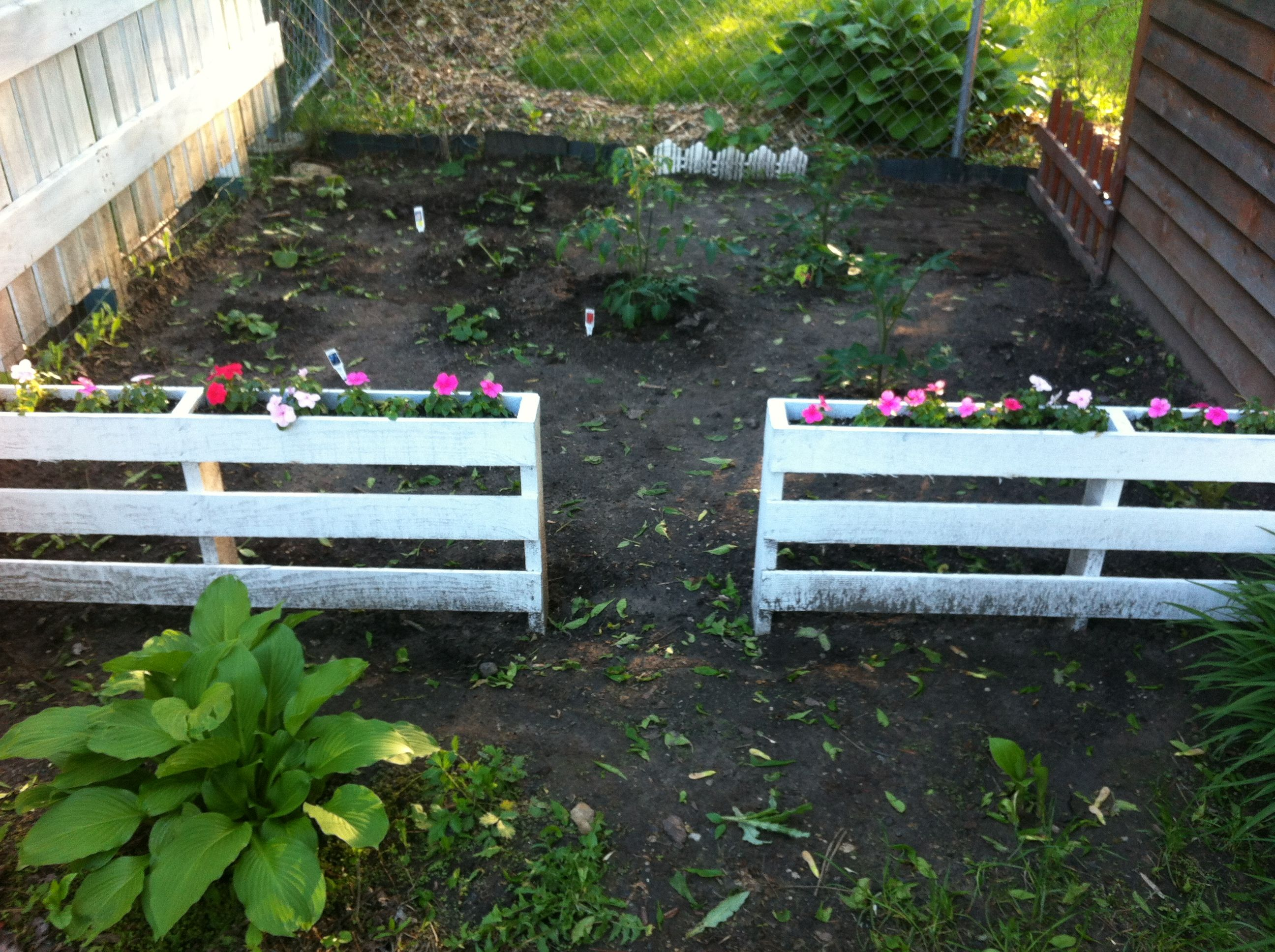 "Garden Fence made from pallets with Flower Boxes.  Cut the boards on one side of the pallet and use for the ""bottoms"" for the Flower Boxes. Paint with white primer or use a paint and primer in one spray paint like I did. Great do-it-yourself project that recycles used pallets! -TK"