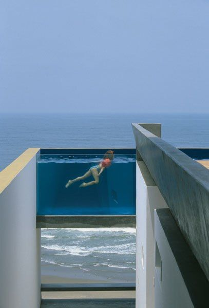 "EQUIS HOUSE POOL IN CAÛETE, PERU Architect Jean Pierre Crousse didn't just photograph this pool—he designed it and the rest of the house, with partner Sandra Barclay. ""I love this pool—very modern,"" Klein says. ""It appears suspended in air, and the glass walls allow you to see through to the other side."" Photo: Jean Pierre Crousse ☮k☮ #architecture"
