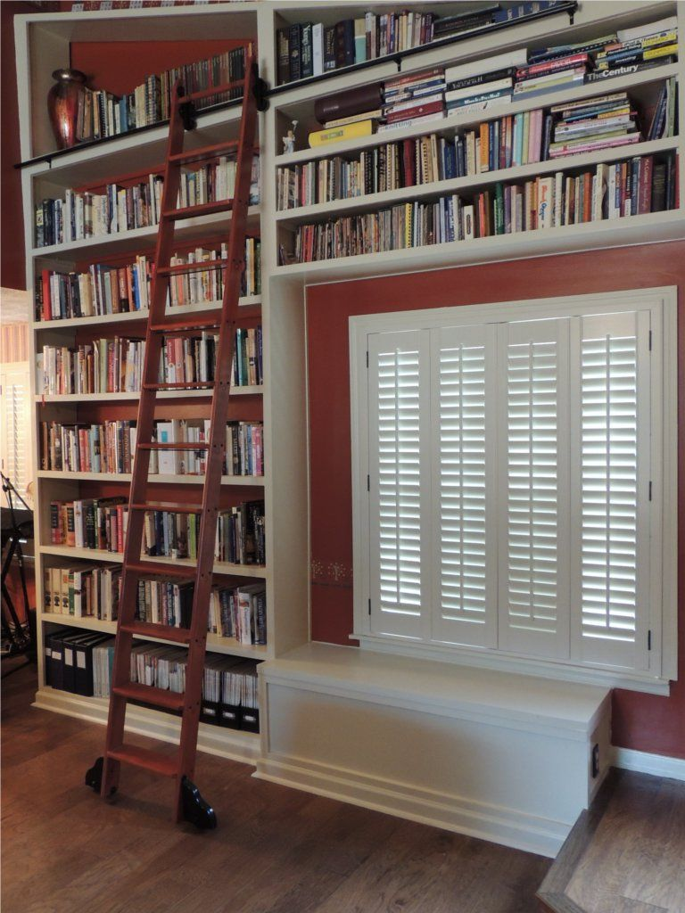 Bookshelves with Seating, Storage and Ladder.