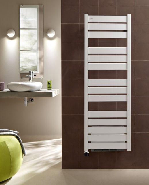Ce sèche-serviettes électrique diffuse une chaleur agréable - puissance seche serviette salle de bain