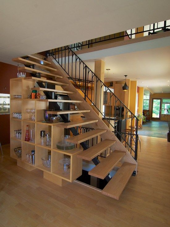 astounding open style woden indoor staircase with classic black metal railing completed with open shelving unit