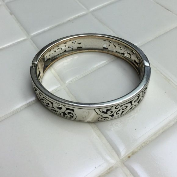 Hinged Bangle Brighton Hinged Silver Bangle. There are some minor scratches and a bit of discoloration. Brighton Jewelry Bracelets