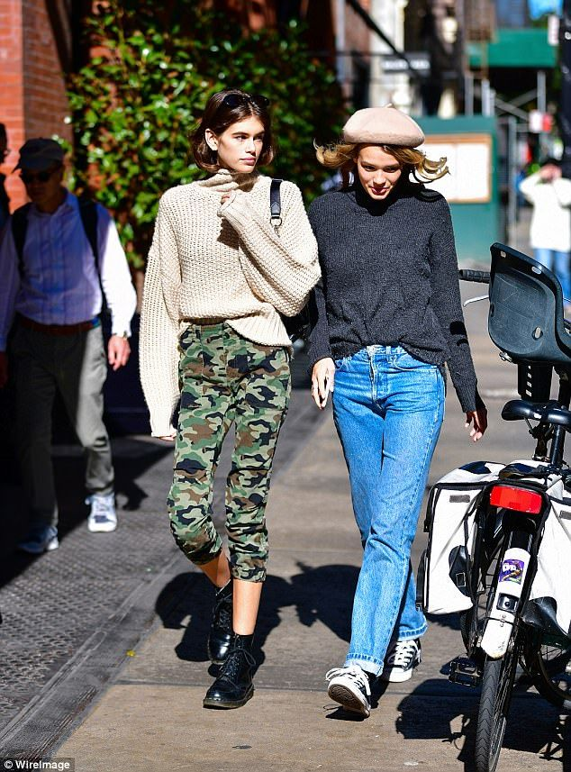 Friends! The 16-year-old budding supermodel sported fall-inspired fashion as she pounded t...